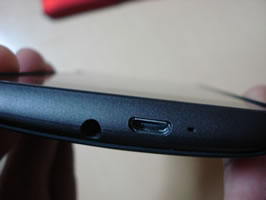Close-up of the bottom of the phone in black case