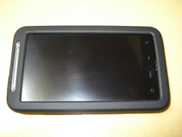 Top view of phone in case lying on desk. Camera flash used.
