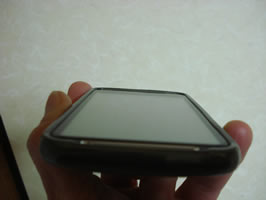 Perspective view of phone showing flushl casing around the screen