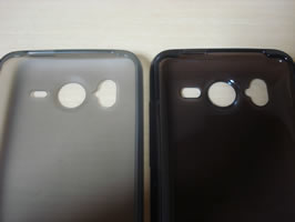 Close-up of Brighton Net and SoftBank TPU Cases side by side to demonstrate the differences in speaker cutout size