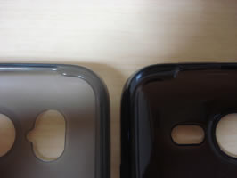 Close-up of top corners of Brighton Net and SoftBank TPU Cases lying side by side