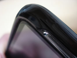 Close-up top left corner of phone with case