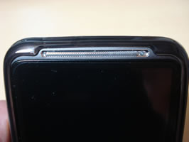 Close up of casing around earpiece or front speaker