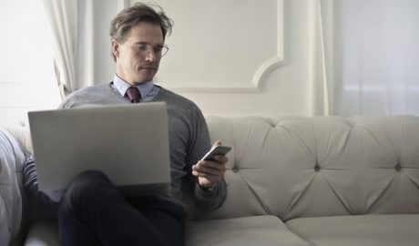 Business guy sitting down with laptop