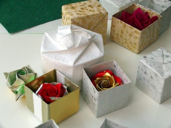 Origami roses in boxes
