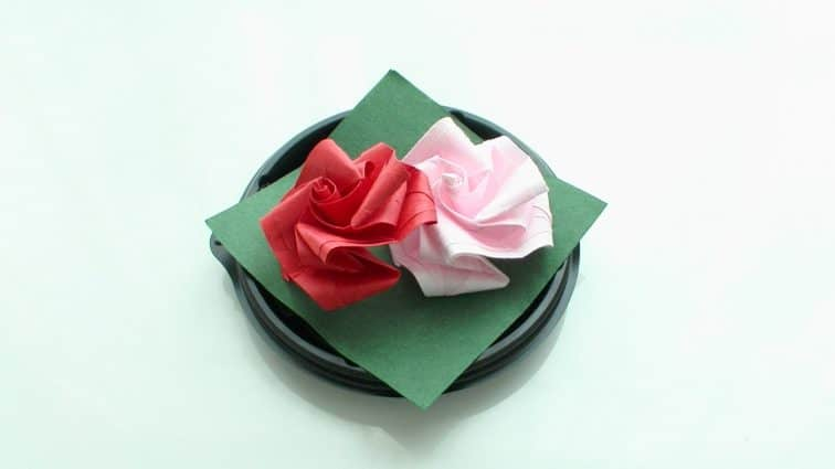 Origami roses on a plate